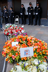 © licensed to London News Pictures. London, UK 17/12/2013. The 30th anniversary of an IRA bomb attack on Harrods which killed six people, including three Metropolitan Police officers on December 17, 1983 is marked by members of Metropolitan Police, relatives and friends of victims and Harrods staff at a special service outside the world-famous department store in London on Tuesday, December 17, 2013. Photo credit: Tolga Akmen/LNP