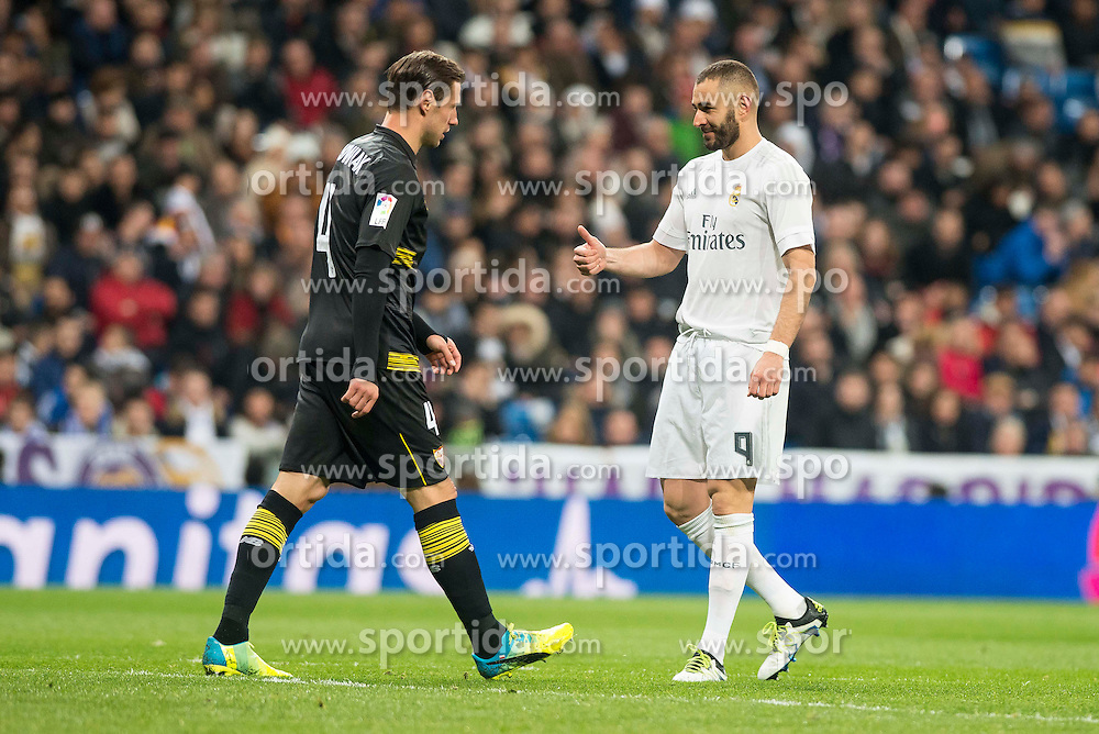 20.03.2016, Estadio Santiago Bernabeu, Madrid, ESP, Primera Division, Real Madrid vs Sevilla FC, 30. Runde, im Bild Real Madrid's Karim Benzema and Sevilla FC's Grzegorz Krychowiak // during the Spanish Primera Division 30th round match between Real Madrid and Sevilla FC at the Estadio Santiago Bernabeu in Madrid, Spain on 2016/03/20. EXPA Pictures &copy; 2016, PhotoCredit: EXPA/ Alterphotos/ Borja B.Hojas<br /> <br /> *****ATTENTION - OUT of ESP, SUI*****