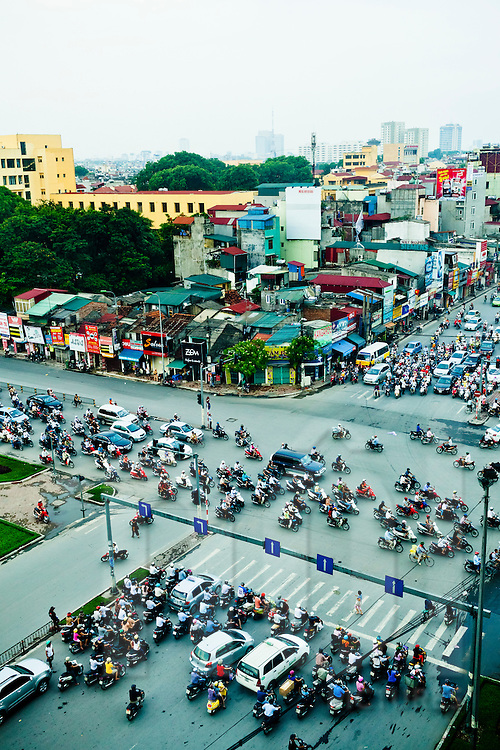 Hectic traffic at a crossroad of Hanoi, Vietnam, Southeast Asia.