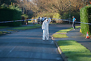 © Licensed to London News Pictures. 27/11/2014. Fetcham, UK. A forensic officer at the scene.  A manhunt is under way across two counties after a man and woman were found stabbed to death in Surrey. The bodies were found at a house in Fetcham, near Leatherhead, after Surrey Police were alerted in the early hours.. Photo credit : Stephen Simpson/LNP
