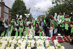June 14, 2018 - London, London, United Kingdom - Grenfell Tower Fire One Year Anniversary. ..Silent procession from St Helen's Church, North Kensington to the base of Grenfell Tower after white doves were released by members of the family. The fire broke out on 14 June 2017 in the 24-storey Grenfell Tower block of public housing flats in North Kensington, West London, in which 72 people lost their lives. (Credit Image: © Dinendra Haria/i-Images via ZUMA Press)