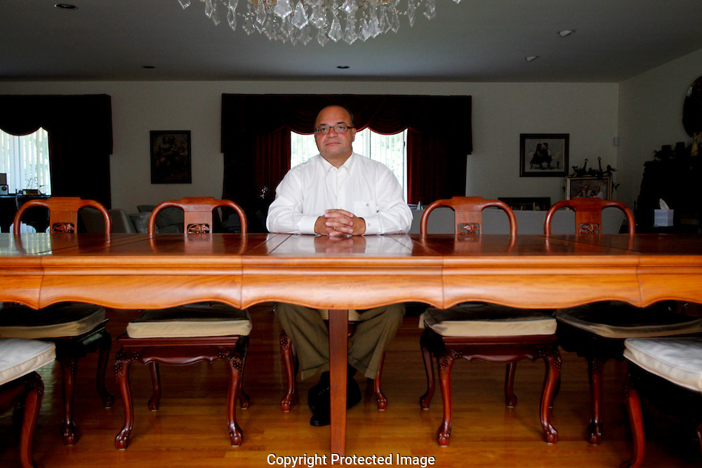 Joseph Caramadre poses for a photo in his home in Cranston, Rhode Island on August 15, 2012.  Joseph, who is the CEO of Estate Planning Resources, Inc., is currently facing sixty-six federal counts of fraud related to variable annuities for the terminally ill.  Matthew Healey for ProPublica
