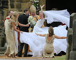 A gust of wind blows Lady Melissa Percy's dress as she arrives for her wedding to Mr.Thomas van Straubenzee , with bridesmaid Chelsy Davy (left) at St.Michaels Church, Alnwick, Northumberland,  Saturday, 22nd June 2013<br /> Picture by:  Stephen Lock / i-Images