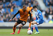 Rajiv van La Parra and Joao Carlos Teixeira, Brighton midfielder during the Sky Bet Championship match between Brighton and Hove Albion and Wolverhampton Wanderers at the American Express Community Stadium, Brighton and Hove, England on 14 March 2015.