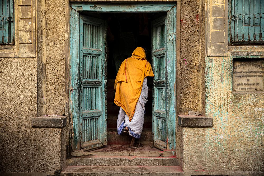 Widow entering an ashram. Vrindavan, India