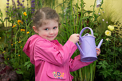 Repro Free: 29/05/2014 Dublin <br /> Ava Browne (4) from Celbridge Co Kildare waters some plants at &lsquo;The Science of Horticulture&rsquo; themed ITB (Institute of Technology Blanchardstown) stand in the Floral Pavilion at Bloom in the Park. Picture Andres Poveda