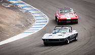 1966 Chevrolet Corvette driven by Dan Richardson, leads through the corkscrew of Laguna Seca, at the Rolex Monterey Motorsports Reunion during Monterey Car Week