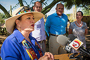 29 AUGUST 2012 - PARADISE VALLEY, AZ:   JOANNE GOLDWATER, left, endorses Dr. RICHARD CARMONA, (center) Democratic candidate for US Senate from Arizona, in Barry Goldwater Memorial Park in Paradise Valley, AZ. Carmona is standing between Goldwater's grandson, TYLER ROSS GOLDWATER and daughter, CC GOLDWATER. Carmona won the endorsements of Joanne Goldwater, daughter of Barry Goldwater, the late legendary Republican Senator from Arizona. He was also endorsed by CC Goldwater, her daughter, and Tyler Ross Goldwater, CC Goldwater's son. Barry Goldwater was from Paradise Valley.    PHOTO BY JACK KURTZ