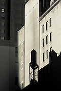 The shadow of a water tank is projected on the wall of a building in the Upper West Side, Manhattan, New York.