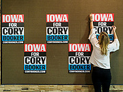 16 APRIL 2019 - CARROLL, IOWA: A campaign worker puts up signs for Senator CORY BOOKER, (D-NJ), in a hotel event room in Carroll, IA. Sen Booker is running to be the Democratic nominee for the US Presidency. Iowa traditionally hosts the the first selection event of the presidential election cycle. The Iowa Caucuses will be on Feb. 3, 2020.       PHOTO BY JACK KURTZ