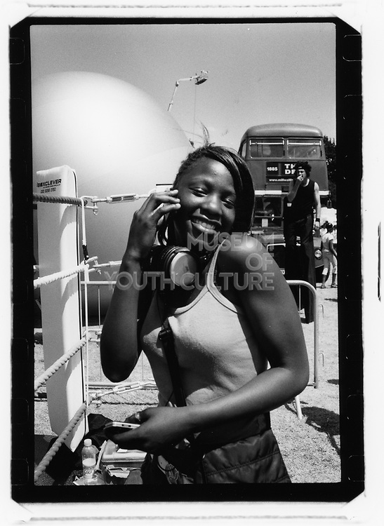 Young black female with headphones, Catford, London, 2010