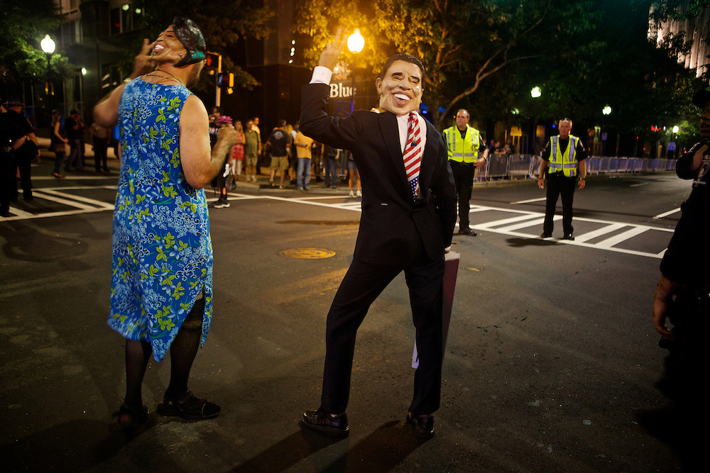 A man and woman wearing their clothes backwards with massks of the President and First Lady walk around the convention area during the 2012 Democratic National Convention on Thursday, September 6, 2012 in Charlotte, NC.