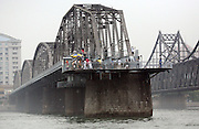 "A view of a bridge that once linked North Korea to China in over the Yalu River July 9, 2006. The bride was bombed ""accidentally"" by Americans during the Korean war and has now been converted in to a war memorial.  DPRK, north korea, china, dandong, border, liaoning, democratic, people's, rebiblic, of, korea, nuclear, test, rice, japan, arms, race, weapons, stalinist, communist, kin jong il"