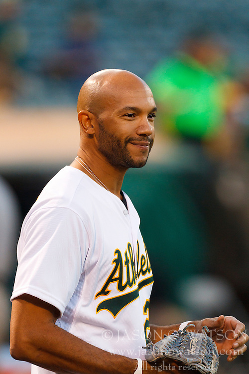 September 20, 2011; Oakland, CA, USA;  Movie actor Stephen Bishop stands on the field before the game between the Oakland Athletics and the Texas Rangers at O.co Coliseum.  Texas defeated Oakland 7-2.