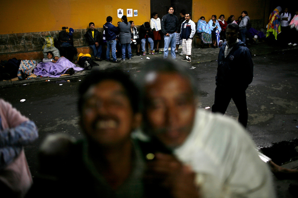 Homeless and relatives of patients gather outside the emergency room of the the San Juan de Dios hospital, Guatemala City, Saturday, June 12, 2010. (AP Photo/Rodrigo Abd)