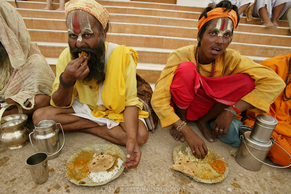 Ascetic sadhu holy men eat a lunch of potato curry, dal, and chapatis provided by a local ashram during the kumbh mela festival in Ujjain, India. (From a photographic gallery of meals in Hungry Planet: What the World Eats, p. 244).
