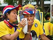 "05 DECEMBER 2015 - BANGKOK, THAILAND:  A woman weeps after shouting ""Long Live the King"" in the plaza at Siriraj Hospital on the 88th birthday of Bhumibol Adulyadej, the King of Thailand. Hundreds of people crowded into the plaza hoping to catch a glimpse of the revered Monarch. The King has lived at Siriraj Hospital off and on for more than four years.    PHOTO BY JACK KURTZ"