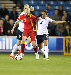 Wales's Helen Bleazard - Chelsea vies for possession with England's Alex Scott (Arsenal) - Photo mandatory by-line: Robin White/JMP - Tel: Mobile: 07966 386802 26/10/2013 - SPORT - FOOTBALL - The Den - Millwall - England Women v Wales Women - World Cup Qualifier - Group 6