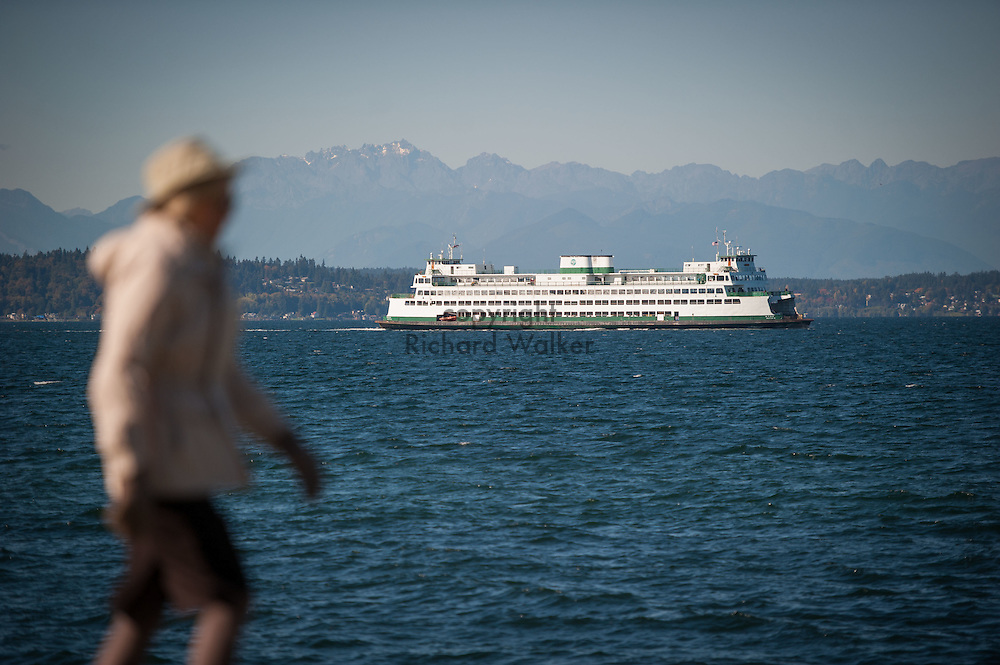 2016 October 11 - Pedestrian walking and Washington State Ferry, off Alki, Puget Sound, West Seattle , Seattle, WA, USA. By Richard Walker