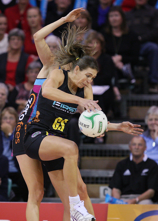 Magic's Irene Van Dyk gets to the ball ahead of Southern Steel's Demelza McCloud in the ANZ Netball Championships at Invercargill Velodrome, Invercargill, New Zealand, Monday, April 02, 2012. Credit:SNPA / Dianne Manson