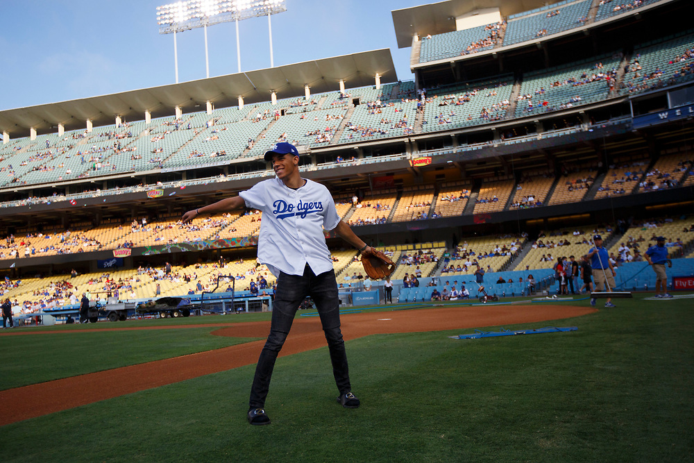 Lakers draft pick Lonzo Ball warms up on the field wearing his BBB sandals before throwing out the first pitch at Dodger Stadium on Friday, June 23, 2017 in El Segundo, California. The Lakers selected Lonzo Ball as the No. 2 overall NBA draft pick and is the son of LaVar Ball. © 2017 Patrick T. Fallon