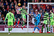 Forest Green Rovers defender Mark Roberts (21) challenges for the ball with Lincoln City defender Rob Dickie (15), on loan from Reading, during the EFL Sky Bet League 2 match between Lincoln City and Forest Green Rovers at Sincil Bank, Lincoln, United Kingdom on 30 December 2017. Photo by Simon Davies.