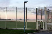 The prison rugby and football pitch. HMP/YOI Portland, a resettlement prison with a capacity for 530 prisoners. Dorset, United Kingdom.