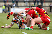 It takes two Dewsbury Rams players to tackle Bradford Bulls full back Ethan Ryan (2) during the Kingstone Press Championship match between Dewsbury Rams and Bradford Bulls at the Tetley's Stadium, Dewsbury, United Kingdom on 10 September 2017. Photo by Simon Davies.