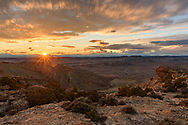 The sun goes down over a rugged canyon near Lovell, Wyoming.
