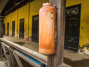 07 JUNE 2014 - YANGON, MYANMAR: An old fire extinguisher in a hotel wing at the Pegu Club. The Pegu Club in Yangon was the Officers' Club for the British Army when Myanmar was the British colony of Burma. The club, principally made of teak, is now abandoned and in decay. Squaters have moved into the parts of the complex still standing. Yangon has the highest concentration of colonial style buildings still standing in Asia. Efforts are being made to preserve the buildings but many are in poor condition and not salvageable.    PHOTO BY JACK KURTZ