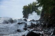 Wild waves crash at Kolekole Gulch Park, Honomu, on the Big Island, Hawaii, USA.