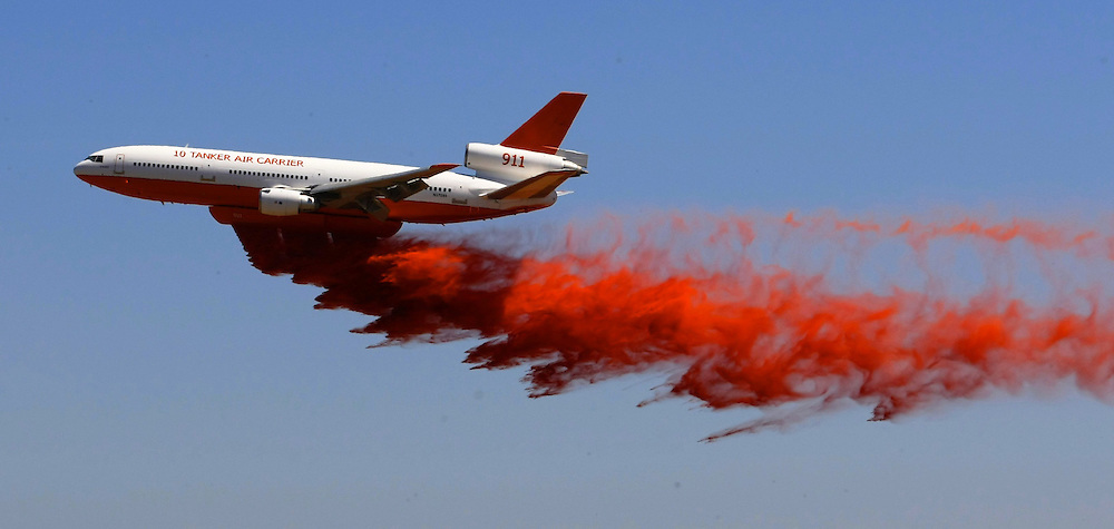 DC9  10 Tanker  water bomber which is being tested for its usefulness during bushfires. Drops a load of fire retardant near Avalon Airport 30/01/2010 Pic By Craig Sillitoe SPECIAL 000 melbourne photographers, commercial photographers, industrial photographers, corporate photographer, architectural photographers, This photograph can be used for non commercial uses with attribution. Credit: Craig Sillitoe Photography / http://www.csillitoe.com<br />