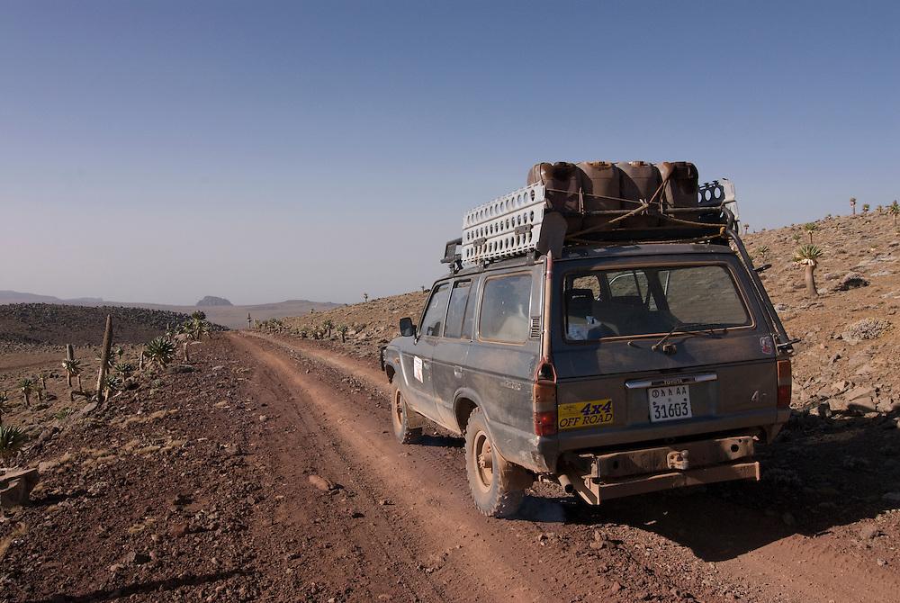Loaded landcruiser on a road on top of the Bale mountains, Ethiopia,Africa