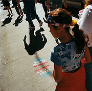 "WTC stencils, Manhattan. Patriotic Americana - After 9/11.Pedestrian shadows pass an aerosol World trade Center stencil. In the week after the September 11th attacks, America sought to express their anger and patriotic unity. .Near New York City?s Armory, where relatives of the victims reported with DNA samples, a stencilled ?rest in peace? message has been sprayed onto the pavement for New Yorkers to walk over while paying their respects to the missing thousands whose pictures adorn the neighbouring walls. ""We're gonna get busy!"" - From the Jay Leno TV show..."