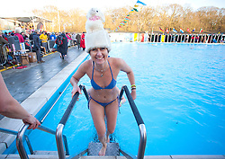 © Licensed to London News Pictures. 24/01/2015. London, UK. Contestant Kobie Mulligan joins the 6th UK Cold Water Swimming Championships at Tooting Bec Lido, south London. Over, 650 swimmers will take the plunge to compete in a variety of chilly races.  Photo credit : Isabel Infantes / LNP