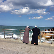 Syrian refugees appreciating the ocean at Corniche Beirut, Lebanon