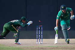 © Licensed to London News Pictures. 28/09/2012. Pakistan wicketkeeper Kamran Akmal attempts a runout of Albie Morkel during the T20 Cricket World cup match between South Africa Vs Pakistan at the R.Premadasa Cricket Stadium,Colombo. Photo credit : Asanka Brendon Ratnayake/LNP