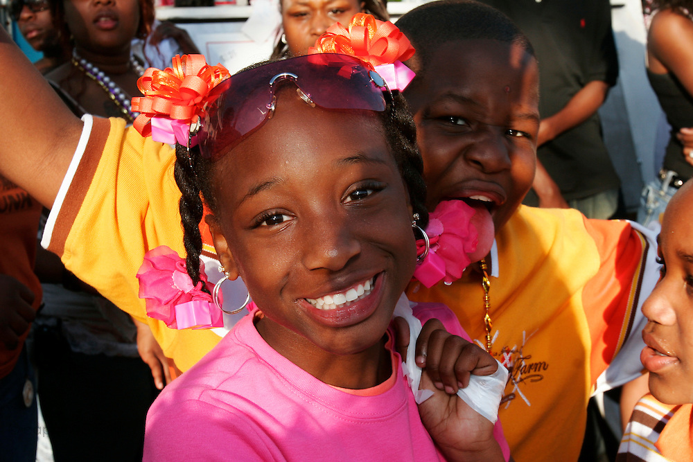 February 28th 2006. .New Orleans, Louisiana. United States..Kids party during the Zulu Mardi gras Walking Parade on Orleans Avenue.