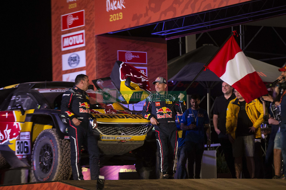LIMA, Jan. 7, 2019  French driver Sebastien Loeb (2nd L) and Monaco co-driver Daniel Elena pose on the podium during the departure ceremony at the 2019 Dakar Rally Race, Lima, Peru, on Jan. 6, 2019. The 41st edition of Dakar Rally Race kicked off in Lima, Peru. (Credit Image: © Xinhua via ZUMA Wire)