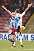 David Mirfin of Scunthorpe United takes ball as Chris Porter of colchester United appeals to the ref  during the Sky Bet League 1 match between Scunthorpe United and Colchester United at Glanford Park, Scunthorpe, England on 23 January 2016. Photo by Ian Lyall.