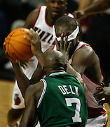 The Blazers'  Zach Randolph (50) gets a hand to the face from the Celtics' Tony Delk (7) who accidentally pulled his swaetband down over his eyes.