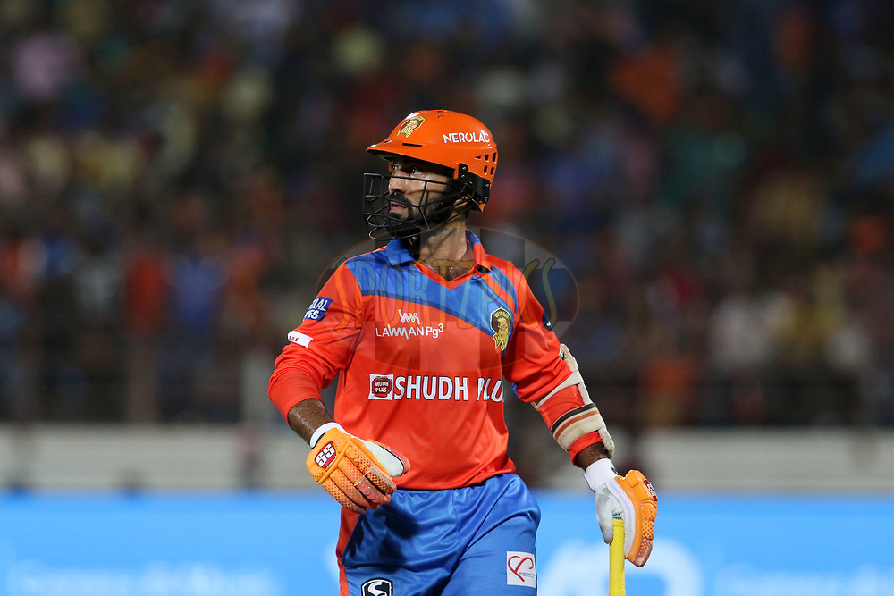 Dinesh Karthik of the Gujarat Lions walks back to the pavilion after getting out during match 35 of the Vivo 2017 Indian Premier League between the Gujarat Lions and the Mumbai Indians  held at the Saurashtra Cricket Association Stadium in Rajkot, India on the 29th April 2017<br /> <br /> Photo by Vipin Pawar - Sportzpics - IPL