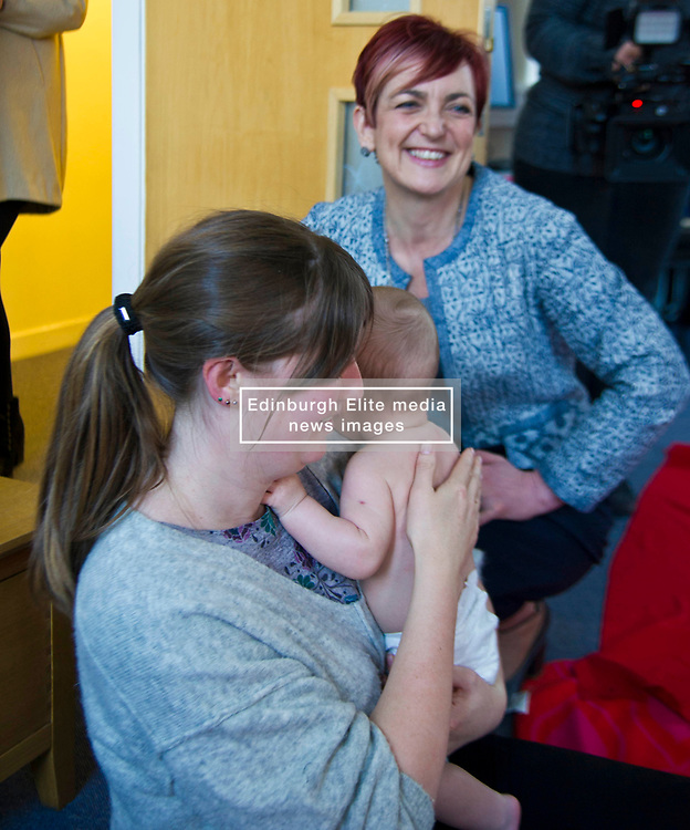 Pictured: Angela Constance, Communities Secretary met Donna Hughes and her son Lorenzo at the baby massage session<br /> Today Communities Secretary  Angela Constance visited Dr Bells family centre, where she met staff and volunteers ahead of the first Tackling Child Poverty Delivery Plan being published.<br /> <br /> <br /> Ger Harley | EEm 29 March 2018