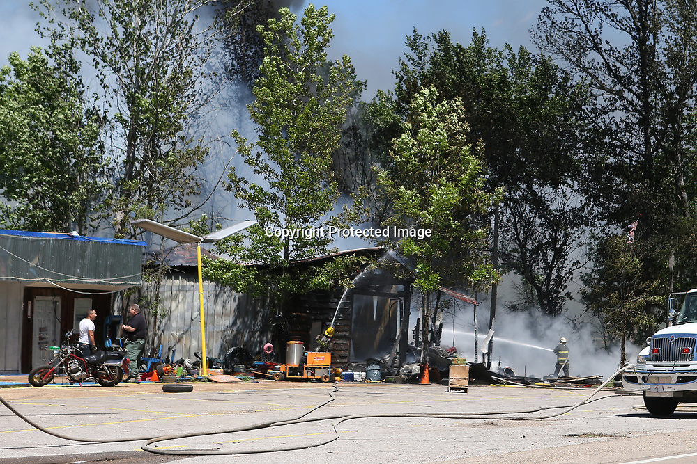 Firefighters with the Mooreville-Eggville and the Richmond Volunteer Fire Departments respond to a fire at General Lee Tire on MS-178 in Mooreville Monday afternoon.