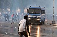 Roma  15 Ottobre 2011.Manifestazione contro la crisi e l'austerità.Scontri tra manifestanti e forze dell'ordine.Un mezzo della polizia  vieni assaltato dai manifestanti in pzza San Giovanni.