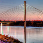 The Kit Bond Bridge over the Missouri River at Kansas City MO at sunset.
