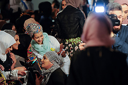 © Licensed to London News Pictures. 18/02/2017. London, UK.   Excited members of the audience await the first catwalk of the day at the UK's first London Modest Fashion Week taking place this weekend at the Saatchi Gallery.  The two day event sees 40 brands from across the world come together to showcase their collections for Muslim and other religious women. Photo credit : Stephen Chung/LNP
