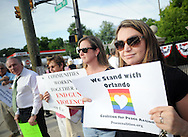 Sarah Grissell, right, of Bensalem, Pennsylvania and a group of supporters of the victims of the Orlando massacre hold signs at Pine and Maple Avenues Wednesday, June 15, 2016 in Langhorne, Pennsylvania.   (Photo by William Thomas Cain)
