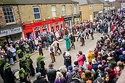 UNITED KINGDOM, Whittlesey: Straw Bear Festival. People gather around Morris dancers as they perform in the town centre of Whittlesey during the Straw Bear festival this weekend. The three day festival, which originated in 1882, consists of traditional Molly, Morris, Clog and Sword dancing as well as parading a large straw character known as 'The Bear' through the town. Rick Findler  / Story Picture Agency