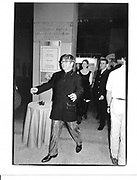 Elton John. ( Isabella rosselini and David Furnish behind. Costume Institute. New York. 1992 approx. © Copyright Photograph by Dafydd Jones 66 Stockwell Park Rd. London SW9 0DA Tel 020 7733 0108 www.dafjones.com